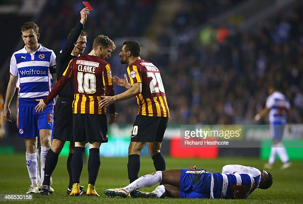 Referee Mike Jones shows the red card to Filipe Morais of Bradford City during the FA Cup Quarter Final Replay match between Reading and Bradford...