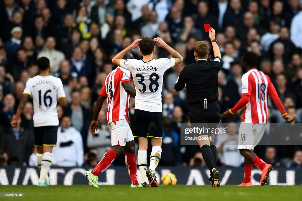 Referee Mike Jones shows the red card to Kyle Naughton #16 (L) of Spurs during the Barclays Premier League match between Tottenham Hotspur and Stoke City at White Hart Lane on November 9, 2014 in London, England.