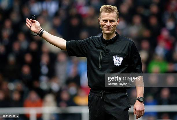 Referee Mike Jones signals a free kick during the Barclays Premier League match between Newcastle United and Manchester City at St James' Park on...