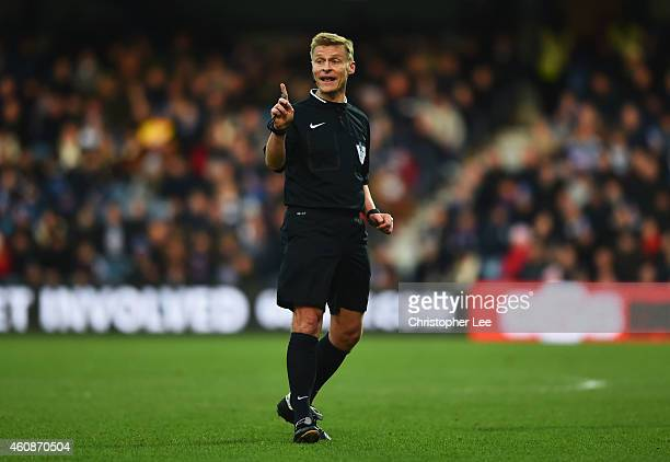 Referee Mike Jones signals during the Barclays Premier League match between Queens Park Rangers and Crystal Palace at Loftus Road on December 28 2014...