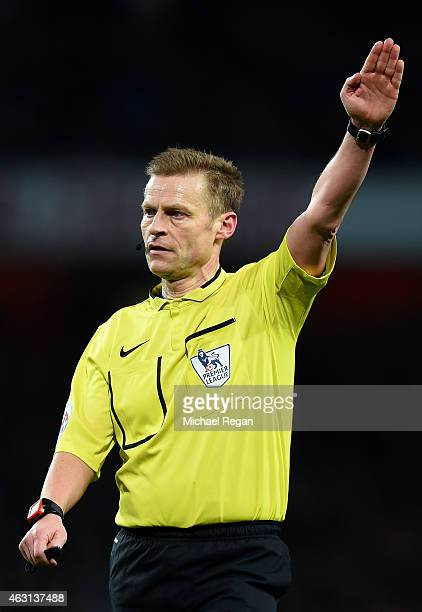 Referee Mike Jones signals during the Barclays Premier League match between Arsenal and Leicester City at Emirates Stadium on February 10 2015 in...