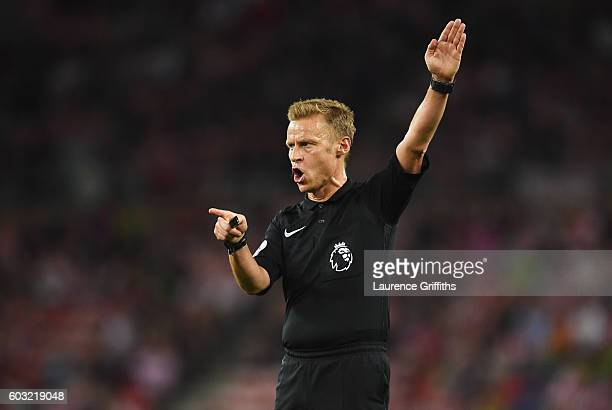 Referee Mike Jones signals during the Premier League match between Sunderland and Everton at Stadium of Light on September 12 2016 in Sunderland...
