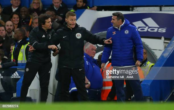 Referee Mike Jones stands between Manchester United assistant coach Rui Faria and Chelsea assistant coach Angelo Alessio during The Emirates FA Cup...