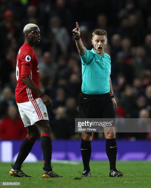 Referee Mike Jones talks to Paul Pogba of Manchester United during the Premier League match between Manchester United and Hull City at Old Trafford...