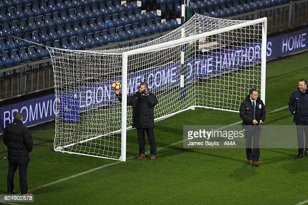 Referee Mike Jones tests the Hawk Eye goal line technology during the Premier League match between West Bromwich Albion and Burnley at The Hawthorns...