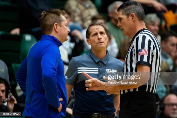 Referee Mike Reed right speaks with Colorado State Rams head coach Niko Medved left and head coach Eric Musselman of the Nevada Wolf Pack during the...