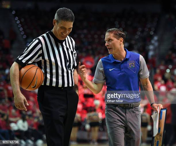 Referee Mike Reed talks with head coach Eric Musselman of the Nevada Wolf Pack during his team's game against the UNLV Rebels at the Thomas Mack...