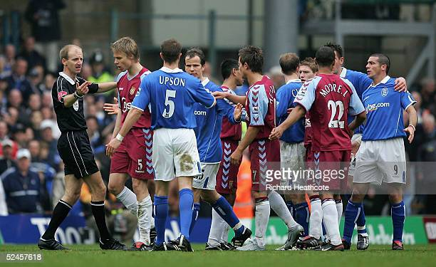 Referee Mike Riley has to separate Stephen Clemence of Birmingham and Martin Laursen of Villa after a foul during The Barclays Premiership match...