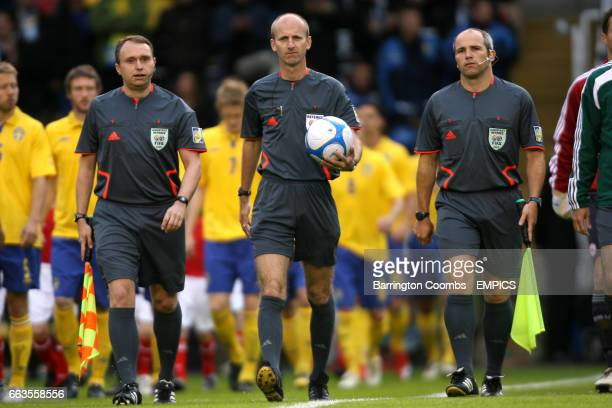 Referee Mike Riley with assistants Darren Cann and Richard West