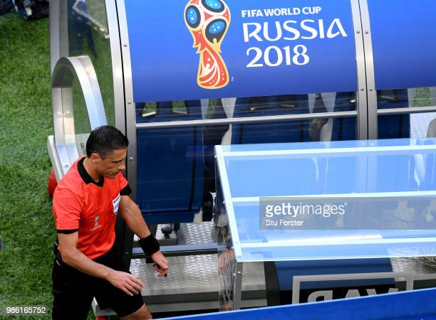 Referee Milorad Mazic consultates VAR after a possible penalty incident between Davinson Sanchez of Colombia and Sadio Mane of Senegal during the...