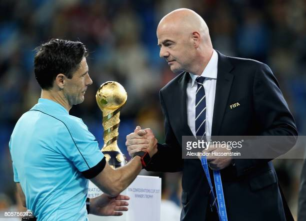 Referee Milorad Mazic shakes hands with Gianni Infantino FIFA president emrbace after the FIFA Confederations Cup Russia 2017 Final between Chile and...