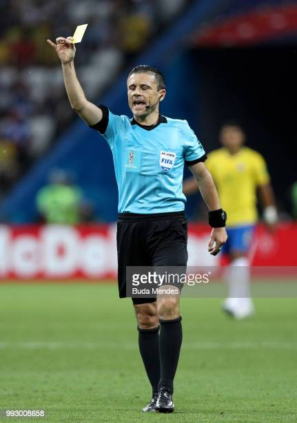 Referee Milorad Mazic shows a yellow card during the 2018 FIFA World Cup Russia Quarter Final match between Brazil and Belgium at Kazan Arena on July...