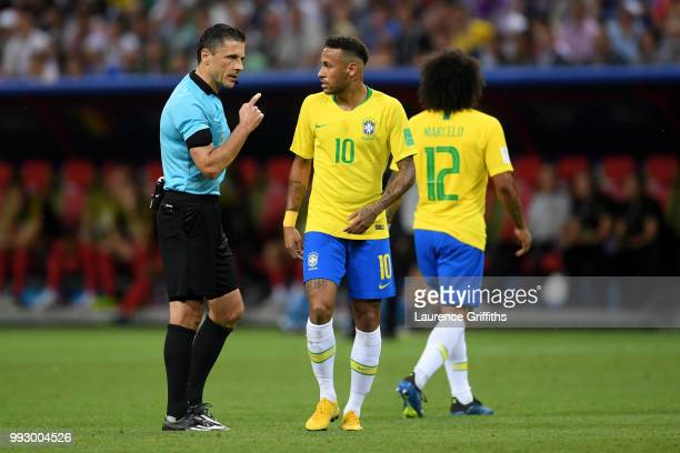 Referee Milorad Mazic speaks to Neymar Jr of Brazil after he dives inside the penalty area during the 2018 FIFA World Cup Russia Quarter Final match...