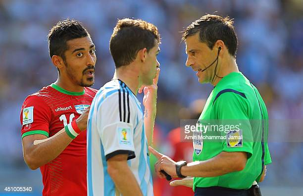 Referee Milorad Mazic speaks to Reza Ghoochannejhad of Iran during the 2014 FIFA World Cup Brazil Group F match between Argentina and Iran at Estadio...