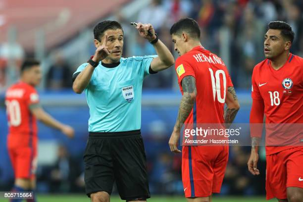 Referee Milorad Mazic talks to Pablo Hernandez of Chile during the FIFA Confederations Cup Russia 2017 Final between Chile and Germany at Saint...
