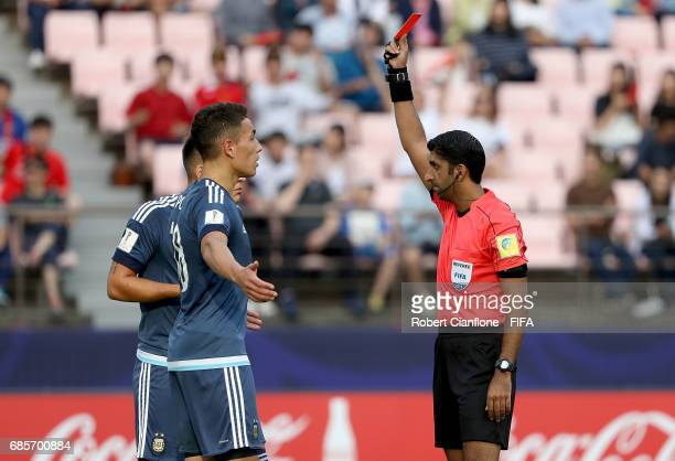 Referee Mohammed Abdulla Hassan gives a red card to Lautaro Martinez of Argentina after reviewing the video review system during the FIFA U20 World...