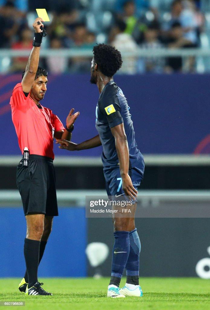 Referee Mohammed Abdullah Hassan awards a yellow card to Josh Onomah of England during the FIFA U-20 World Cup Korea Republic 2017 Quarter Final match between Mexico and England at Cheonan Baekseok Stadium on June 5, 2017 in Cheonan, South Korea.