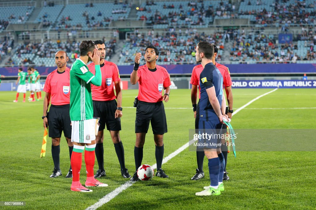Referee Mohammed Abdullah Hassan flips the coin with Alan Cervantes of Mexico and Lewis Cook of England before the FIFA U-20 World Cup Korea Republic 2017 Quarter Final match at Cheonan Baekseok Stadium on June 5, 2017 in Cheonan, South Korea.