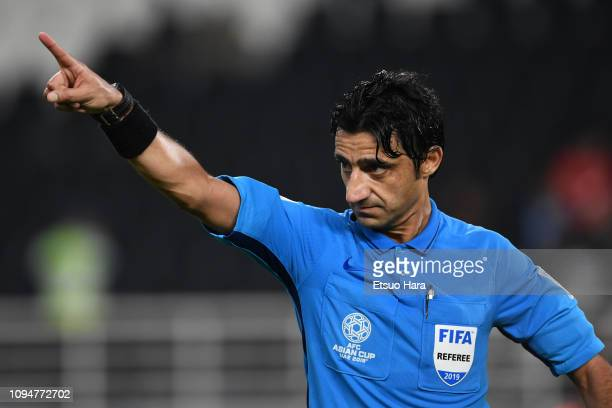 Referee Mohanad Qasim Eesee Sarray of Iraq gestures during the AFC Asian Cup Group B match between Palestine and Jordan at Mohammed Bin Zayed Stadium...