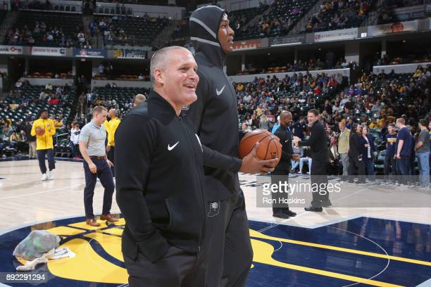 Referee Monty McCutchen and Myles Turner of the Indiana Pacers stand on the court before the game against the Denver Nuggets on December 10 2017 at...