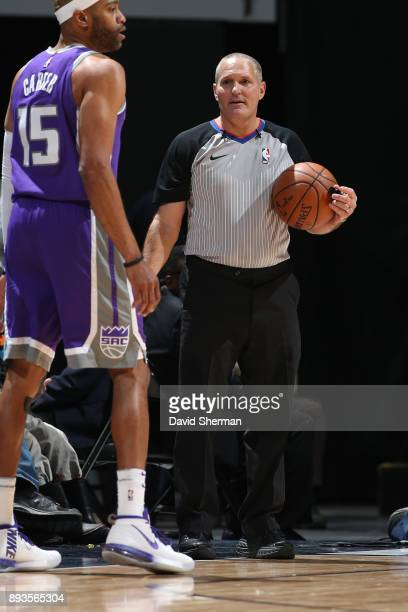 Referee Monty McCutchen runs up court during the game against the Sacramento Kings on December 14 2017 at Target Center in Minneapolis Minnesota NOTE...