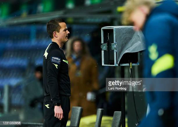 Referee Morten Krogh watching the VAR monitor during the Danish 3F Superliga match between Brondby IF and AaB Aalborg at Brondby Stadion on February...