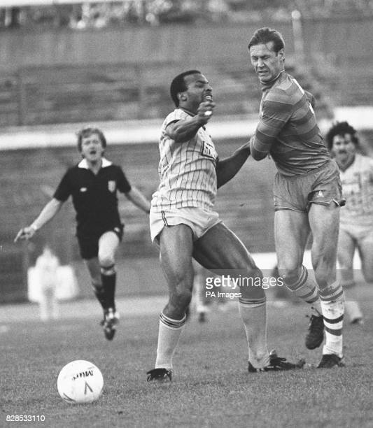 Referee Mr IJ Barrett rushed to intervene in the scuffle between Coventry striker Cyrille Regis and Chelsea defender Doug Rougvie during the first...