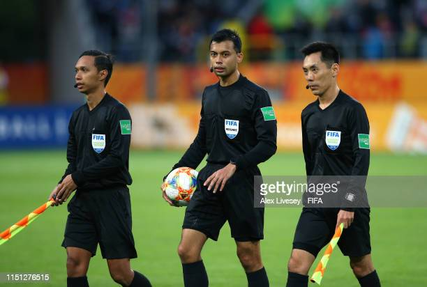 Referee Muhammad Bin Jahari and his assistants Ronnie Min Kiat Koh and Hannan Bin Abdul during the 2019 FIFA U20 World Cup group A match between...