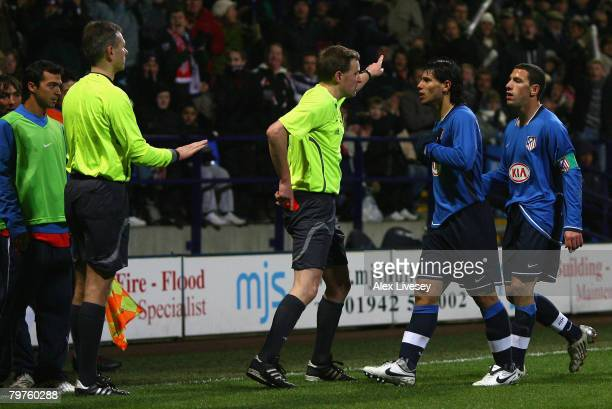 Referee N Vollquartz shows a red card to Sergio Aguero of Atletico Madrid during the UEFA Cup Round of 32 First Leg match between Bolton Wanderers...