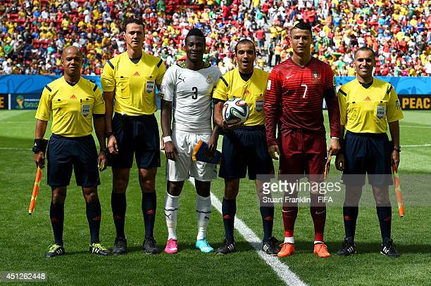 Referee Nawaf Shukralla Asamoah Gyan of Ghana Cristiano Ronaldo of Portugal assistant referees and fourth official pose for photographs prior to the...