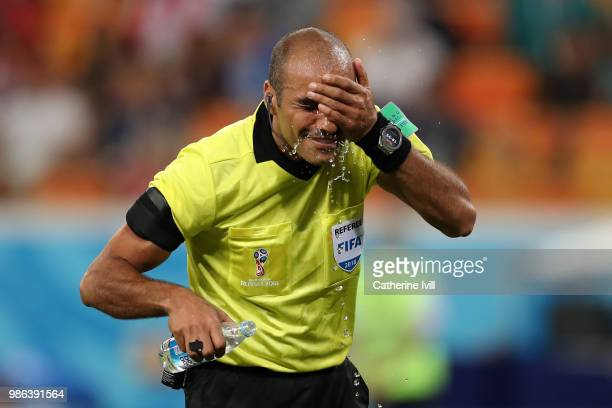 Referee Nawaf Shukralla cools off during the 2018 FIFA World Cup Russia group G match between Panama and Tunisia at Mordovia Arena on June 28 2018 in...