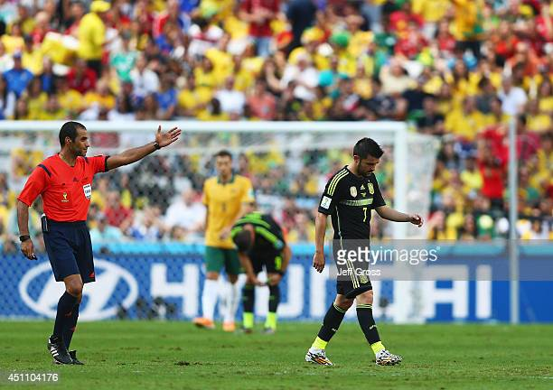 Referee Nawaf Shukralla gestures as David Villa of Spain walks off the field during the 2014 FIFA World Cup Brazil Group B match between Australia...