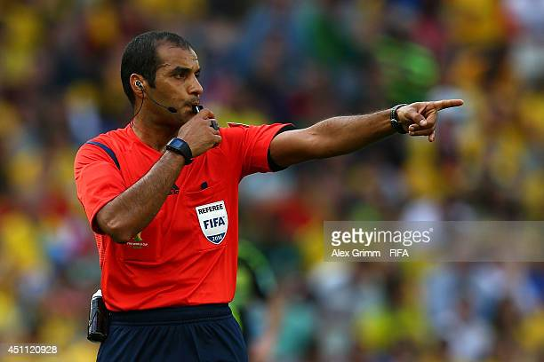Referee Nawaf Shukralla gestures during the 2014 FIFA World Cup Brazil Group B match between Australia and Spain at Arena da Baixada on June 23 2014...