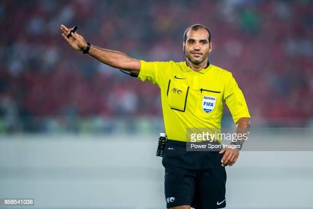 Referee Nawaf Shukralla gestures during the AFC Champions League 2015 Semi Final 1st Leg match between Guangzhou Evergrande and Gamba Osaka on...