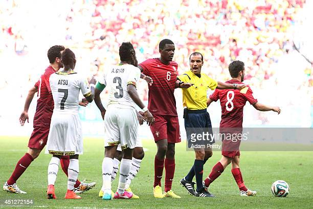 Referee Nawaf Shukralla intervenes during the 2014 FIFA World Cup Brazil Group G match between Portugal and Ghana at Estadio Nacional on June 26 2014...