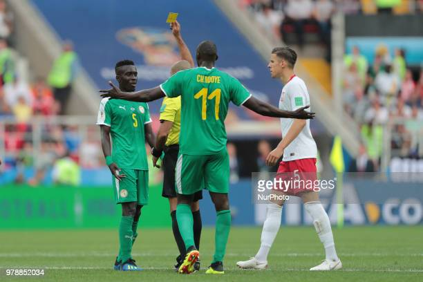 Referee Nawaf Shukralla shows the yellow card to defender Kalidou Koulibaly of Senegal National team during the group H match between Poland and...