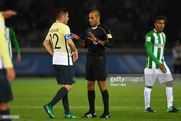Referee Nawaf Shukralla speaks to Pablo Aguilar#12 of Club America during the FIFA Club World Cup 3rd place match between Club America and Atletico...