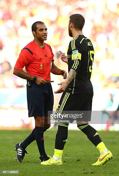 Referee Nawaf Shukralla speaks to Sergio Ramos of Spain during the 2014 FIFA World Cup Brazil Group B match between Australia and Spain at Arena da...