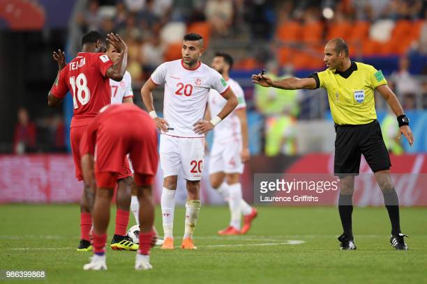Referee Nawaf Shukralla talks to Luis Tejada of Panama and Ghaylen Chaaleli of Tunisia during the 2018 FIFA World Cup Russia group G match between...