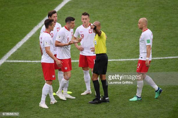 Referee Nawaf Shukralla talks to Robert Lewandowski of Poland during the 2018 FIFA World Cup Russia group H match between Poland and Senegal at...