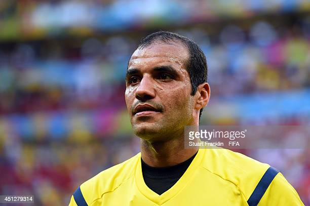 Referee Nawaf Shukralla walks off the pitch after the 2014 FIFA World Cup Brazil Group G match between Portugal and Ghana at Estadio Nacional on June...
