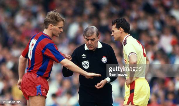 Referee Neil Midgley points at Crystal Palace captain Geoff Thomas after Thomas had just tossed the coin watched by John Humphrey before the League...