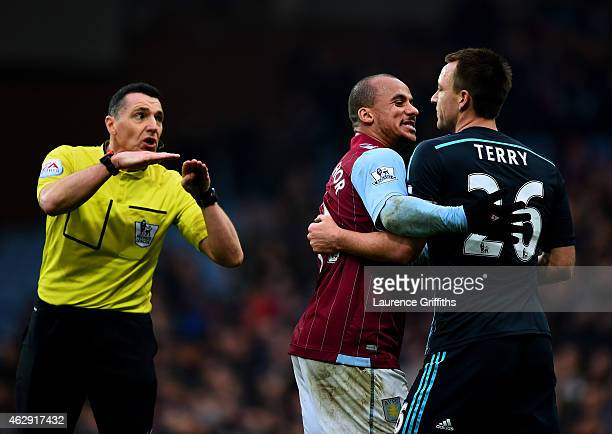 Referee Neil Swarbrick gestures as Gabriel Agbonlahor of Aston Villa speaks with John Terry of Chelsea during the Barclays Premier League match...