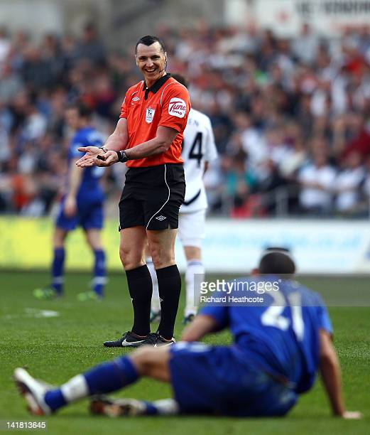 Referee Neil Swarbrick gestures to Leon Osman of Everton during the Barclays Premier League match between Swansea City and Everton at the Liberty...