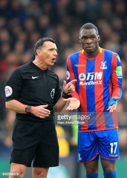 Referee Neil Swarbrick has words with Christian Benteke of Crystal Palace during the Premier League match between Crystal Palace and Liverpool at...
