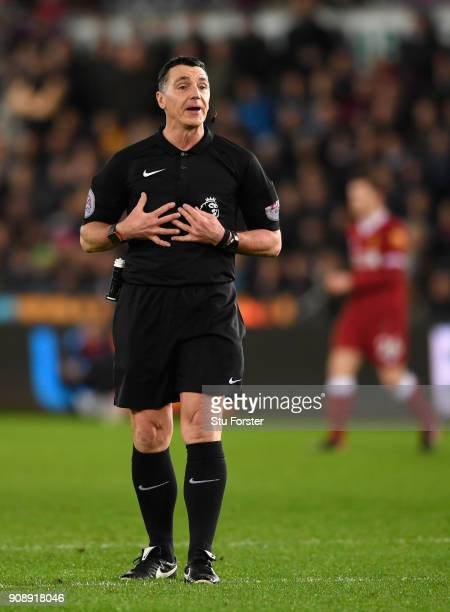 Referee Neil Swarbrick reacts during the Premier League match between Swansea City and Liverpool at Liberty Stadium on January 22 2018 in Swansea...