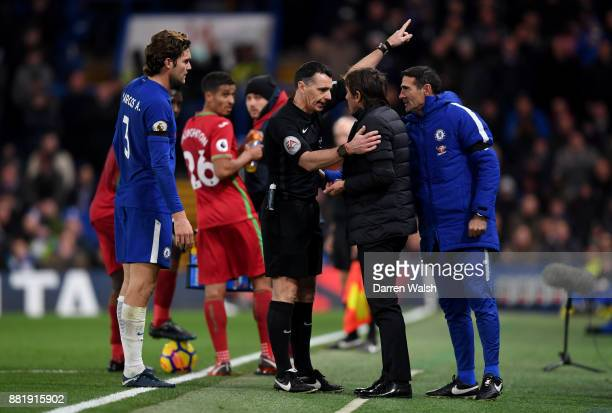Referee Neil Swarbrick sends Antonio Conte Manager of Chelsea to the stands during the Premier League match between Chelsea and Swansea City at...