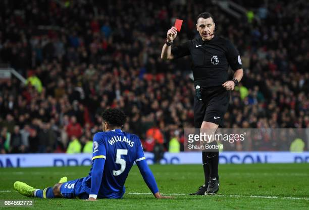Referee Neil Swarbrick shows Ashley Williams of Everton a red card during the Premier League match between Manchester United and Everton at Old...