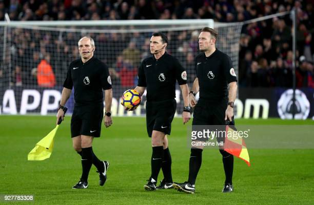 Referee Neil Swarbrick with assistants SLedger and RWest during the Premier League match between Crystal Palace and Manchester United at Selhurst...