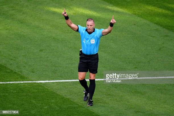 Referee Nestor Pitana announces a VAR review during the 2018 FIFA World Cup Russia group F match between Mexico and Sweden at Ekaterinburg Arena on...